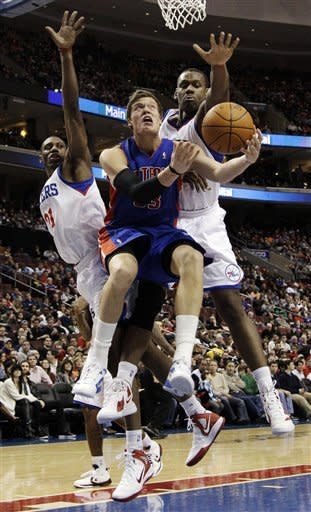 Detroit Pistons' Jonas Jerebko, center, of Sweden, goes up for a shot as Philadelphia 76ers' Thaddeus Young, left, and Lavoy Allen defend in the first half of an NBA basketball game, Saturday, Jan. 28, 2012, in Philadelphia. (AP Photo/Matt Slocum)