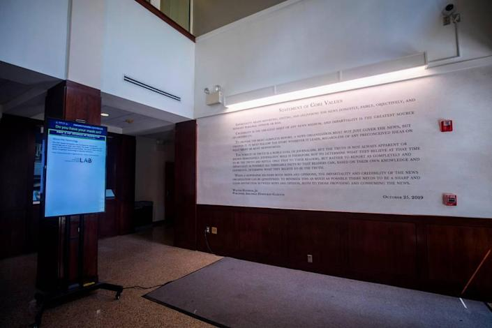 """Walter Hussman Jr.'s """"statement of core values"""" can be seen on the wall in the lobby of Carroll Hall in Chapel Hill, N.C., where the Hussman School of Journalism and Media is located, pictured here on Wednesday, July 14, 2021."""
