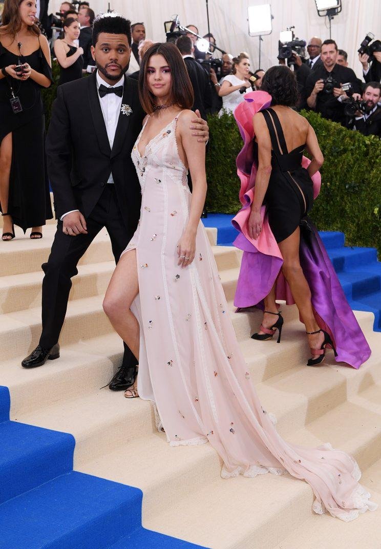 bd07120d7d2 Selena Gomez Wears a Wedding-Like Dress to the Met Gala With The Weeknd