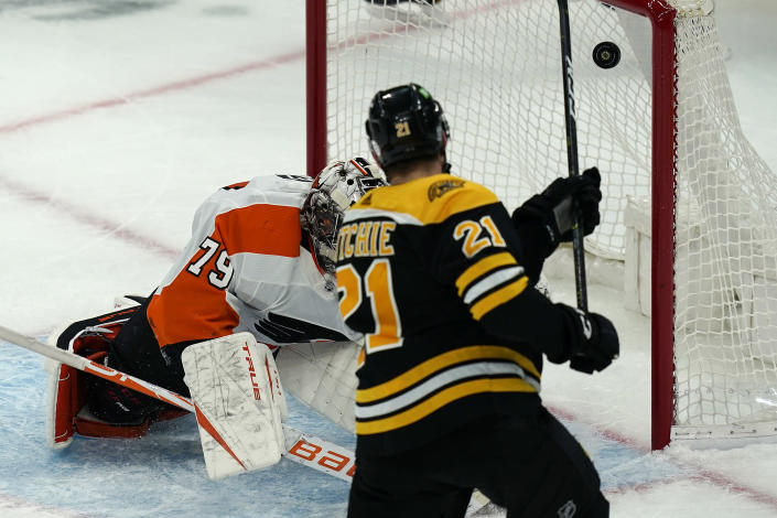 Boston Bruins left wing Nick Ritchie (21) scores against Philadelphia Flyers goaltender Carter Hart (79) in the third period of an NHL hockey game, Thursday, Jan. 21, 2021, in Boston. (AP Photo/Elise Amendola)