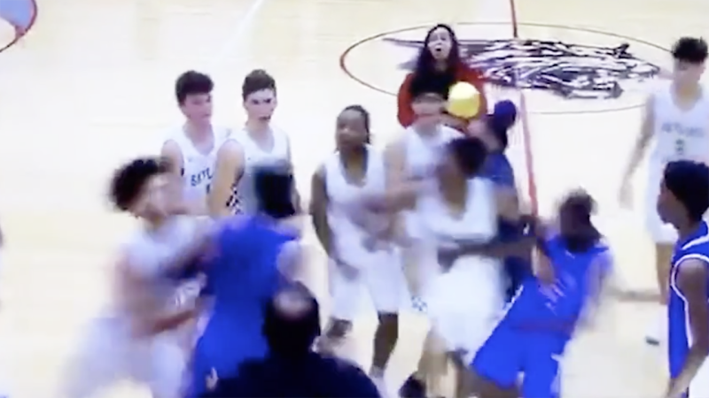 The moment a brawl breaks out between two high school basketball teams in Phoenix, Arizona. Picture: The Arizona Republic