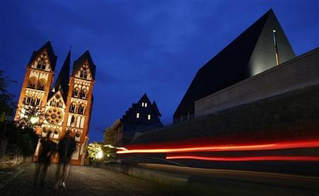 A car drives past the residence of Tebartz-van Elst next to Limburg Cathedral in Limburg