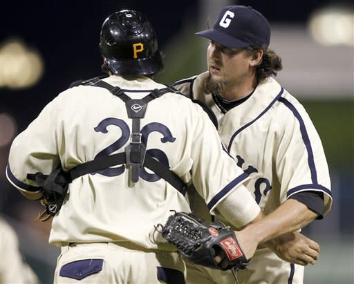 Pittsburgh Pirates relief pitcher Joel Hanrahan, right, is greeted by Pirates catcher Rod Barajas (26) after getting the save against the Kansas City Royals and ending the ninth inning of a baseball game on Saturday, June 9, 2012, in Pittsburgh. The Pirates won 5-3. (AP Photo/Keith Srakocic)