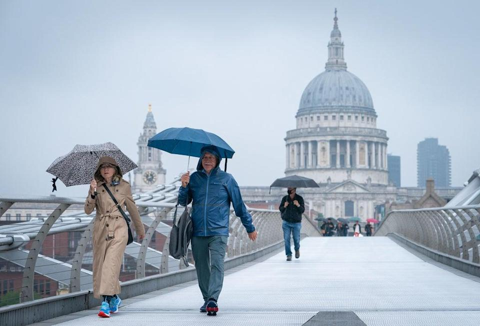 London was hit by heavy rain and more is on the way.  (PA)