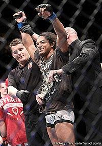 Benson Henderson (C) is fitted with the UFC lightweight belt by UFC president Dana White after beating Frankie Edgar