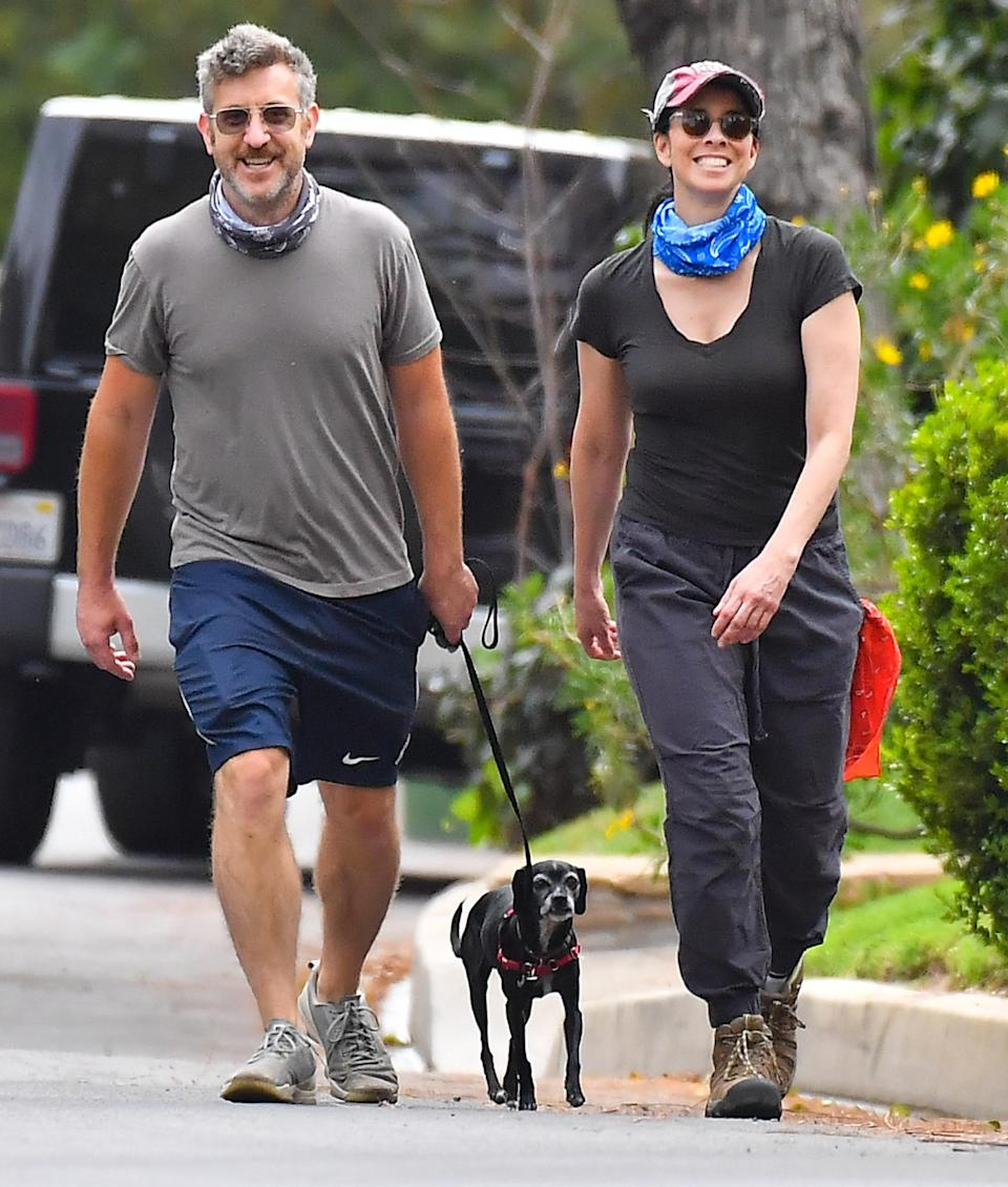 <p>Sarah Silverman and boyfriend Rory Albanese are all smiles while walking their dog in L.A. on Thursday.</p>