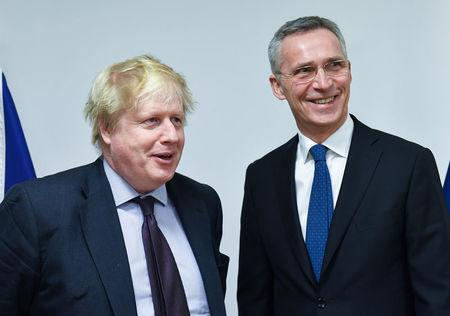 British Foreign Secretary Boris Johnson poses with NATO Secretary-General Jens Stoltenberg at the Alliance headquarters in Brussels, Belgium, March 19, 2018.  Emmanuel Dunand/Pool via Reuters