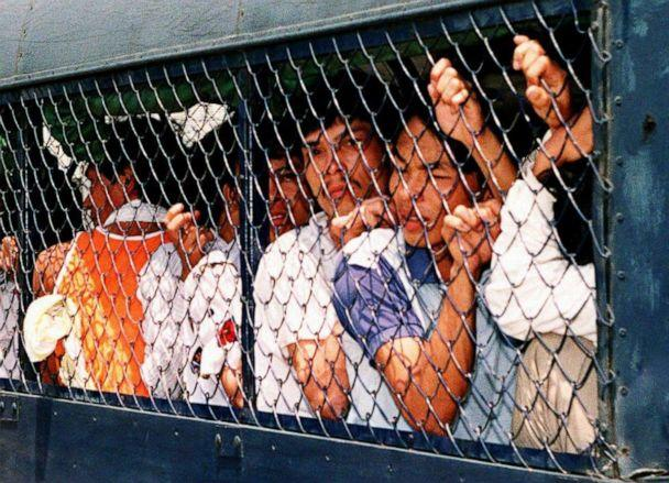 PHOTO: Vietnamese boat people from the Whitehead detention center are crowded into a police truck for relocation to another detention center in Hong Kong on April 7, 1994. (Thomas Cheng/AFP via Getty Images, FILE)
