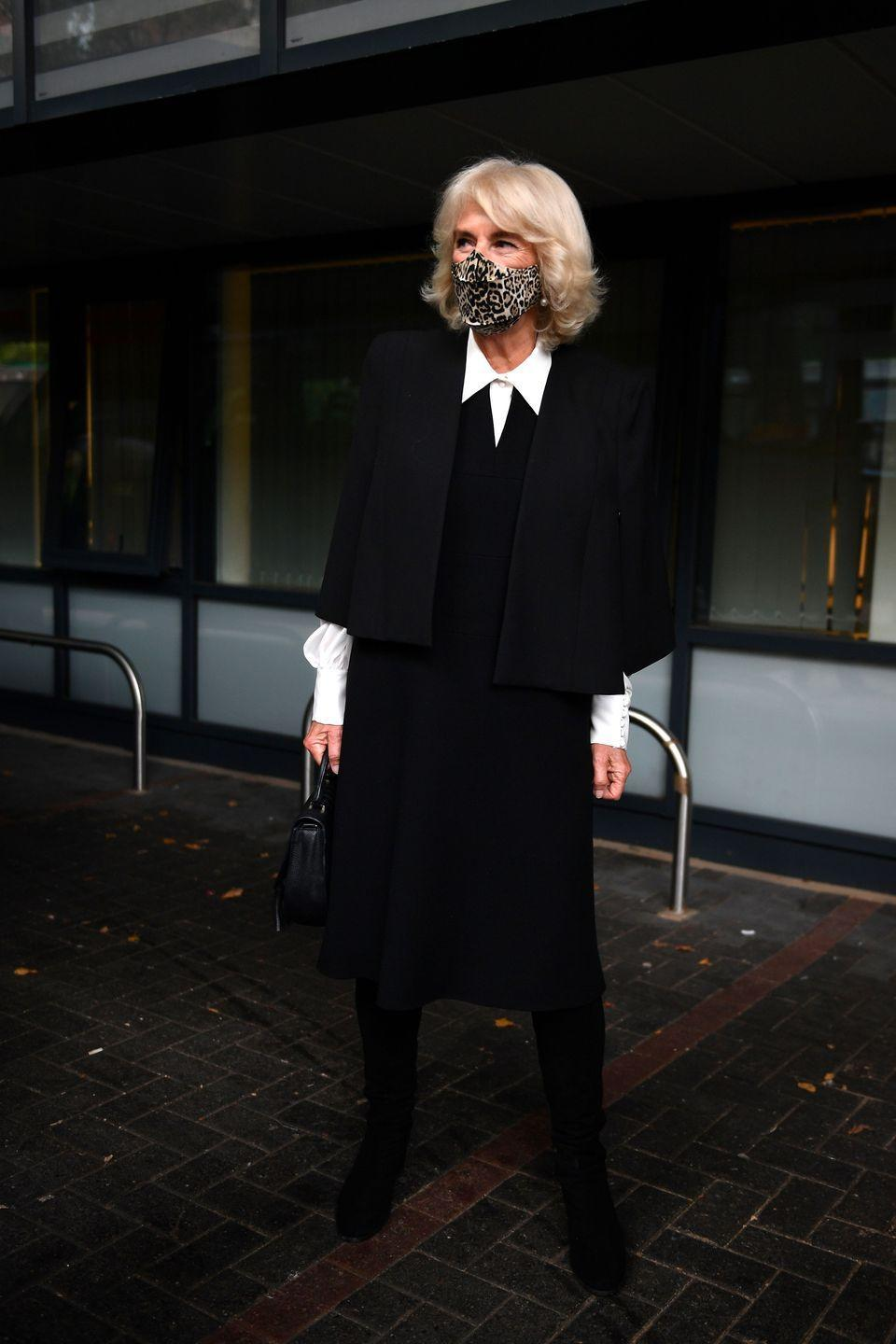 <p>During a day of outings in London, Camilla wore a sophisticated black and white look, accented with a funky leopard-print mask. </p>