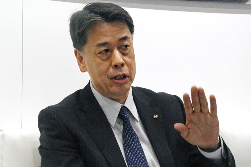 In this April 16, 2019, photo, Nissan Motor Co.'s Senior Vice President Makoto Uchida speaks to the media at Shanghai International Motor Show in Shanghai, China. Japanese automaker Nissan Motor Co. announced Tuesday, Oct. 8, 2019, that its board has named the head of its China business, Uchida, to be its new CEO.(Kyodo News via AP)