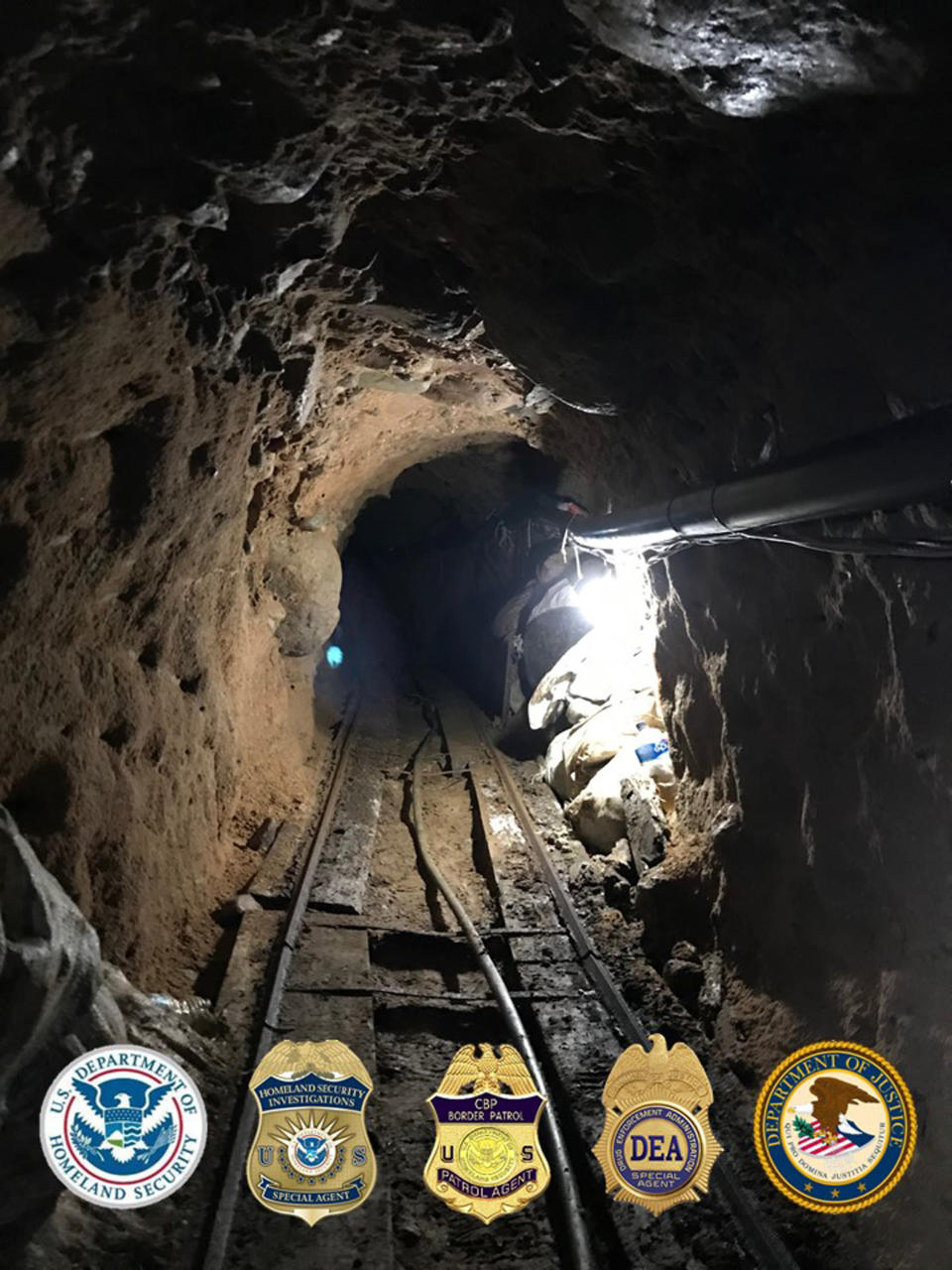 This photo released Tuesday, March 31 2020, by the San Diego Tunnel Task Force, Department of Homeland Security, shows a rail system in a cross-border tunnel running from warehouses in Tijuana, Mexico to San Diego. U.S. authorities seized a large haul of drugs including opioids, methamphetamine and cocaine, being smuggled through the tunnel equipped with ventilation, lighting and an underground rail system. Authorities believe it existed for several months. (San Diego Tunnel Task Force/Department of Homeland Security via AP)