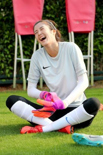 Fun-loving footballer: Zhao Lina laughs during a break in training in Shanghai
