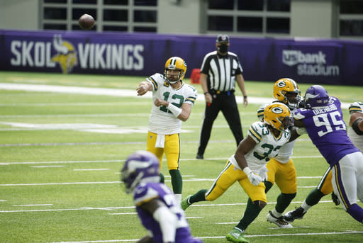 Green Bay Packers quarterback Aaron Rodgers (12| throws a pass during the first half of an NFL football game against the Minnesota Vikings, Sunday, Sept. 13, 2020, in Minneapolis. (AP Photo/Bruce Kluckhohn)