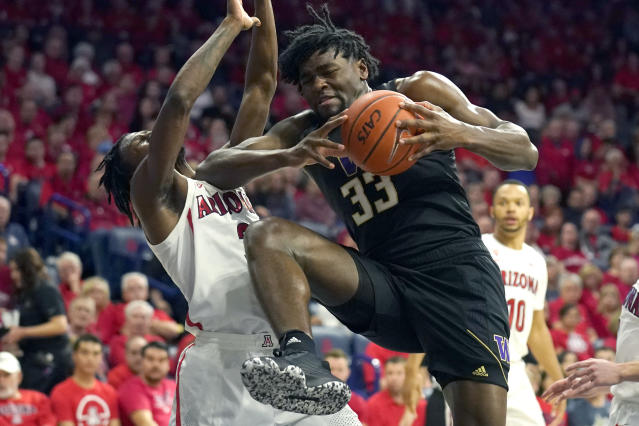Washington forward Isaiah Stewart drives on Arizona guard Dylan Smith (3) during the first half of an NCAA college basketball game Saturday, March 7, 2020, in Tucson, Ariz. Smith broke his nose on the play. (AP Photo/Rick Scuteri)