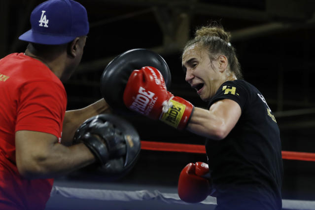 Croatian boxer Ivana Habazin spars with trainer James Ali Bashir during a training session, Wednesday, Oct. 2, 2019, in Detroit. Habazin will fight Claressa Shields for the vacant World Boxing Organization Junior Middleweight title in Flint, Mich., on Saturday night. (AP Photo/Carlos Osorio)
