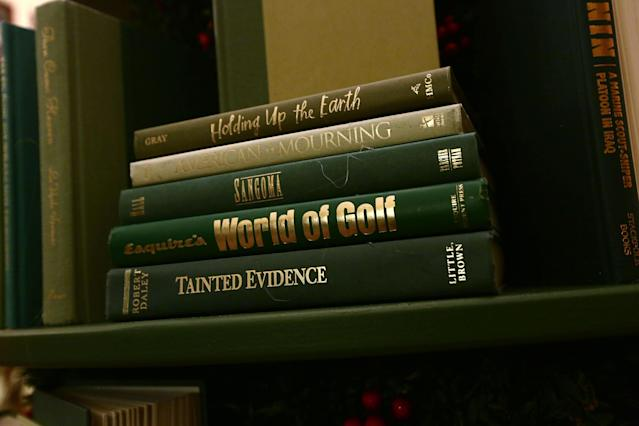 <p>Detail shot of the book volumes that form a Christmas tree in the library at the White House during a press preview of the 2017 holiday decorations Nov. 27, 2017 in Washington, D.C. (Photo: Alex Wong/Getty Images) </p>