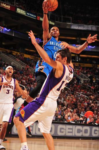 PHOENIX, AZ - APRIL 18: Russell Westbrook #0 of the Oklahoma City Thunder goes to the basket against Steve Nash #13 of the Phoenix Suns on April 18, 2012 at U.S. Airways Center in Phoenix, Arizona. (Photo by Barry Gossage/NBAE via Getty Images)