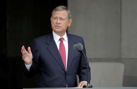 FILE PHOTO: U.S. Supreme Court Chief Justice John Roberts speaks at the dedication of the Smithsonian's National Museum of African American History and Culture in Washington, U.S., September 24, 2016.      REUTERS/Joshua Roberts/File Photo