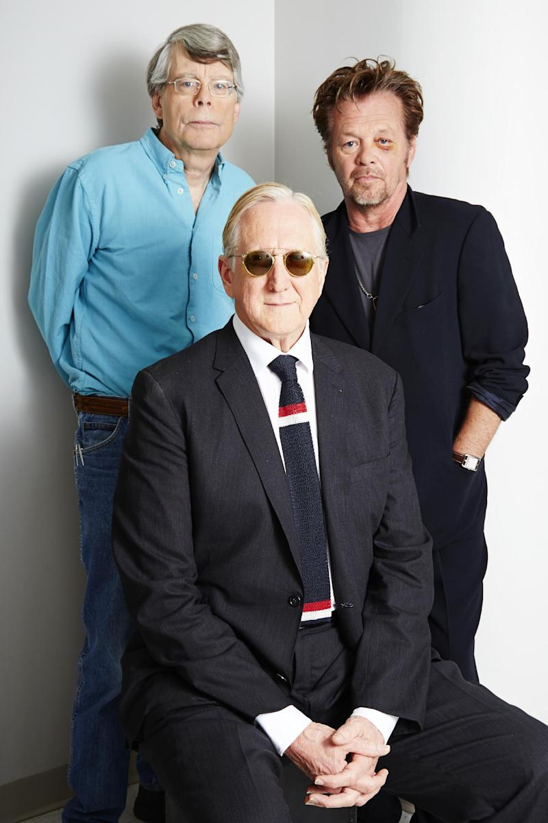 """This June 3, 2013 photo shows, from left, Stephen King, T Bone Burnett and John Mellencamp posing for a portrait in New York. The trio are collaborating on a musical, """"Ghost Brothers of Darkland County."""" A traveling production will begin later this year. (Photo by Dan Hallman/Invision/AP)"""