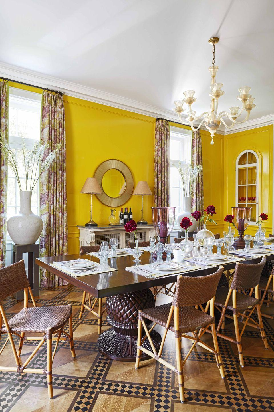 """<p>Can't you just feel the warmth in this room? It's no surprise the color yellow evokes feelings of energy, brightness, and those warm fuzzies, making it great for donning a room or two in your home. We love this rich lacquered yellow in designer <a href=""""https://www.veranda.com/decorating-ideas/a27105026/katie-ridder-hamptons-home/"""" rel=""""nofollow noopener"""" target=""""_blank"""" data-ylk=""""slk:Katie Ridder's Hamptons dining room"""" class=""""link rapid-noclick-resp"""">Katie Ridder's Hamptons dining room</a>, which invites stimulating conversation and keeps guests feeling cheerful no matter how gray and dreadful it may get outside. </p>"""