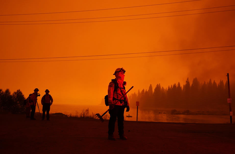 A firefighter watches the advancing Creek Fire, Sunday, September 6. Source: AP