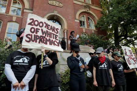 """FILE PHOTO: Protesters gather at the University of Virginia, ahead of the one year anniversary of the 2017 Charlottesville """"Unite the Right"""" protests, in Charlottesville, Virginia, U.S., August 11, 2018.     REUTERS/Lucas Jackson/File Photo"""