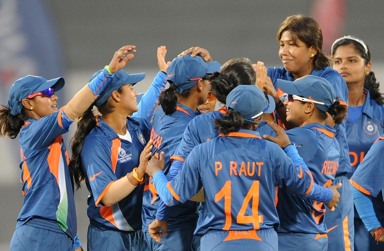 Indian cricketers celebrate the run out of Kycia Knight of West Indies during the inaugural match of the ICC Women's World Cup 2013 between India and West Indies at the Cricket Club of India's Brabourne stadium in Mumbai on January 31, 2013.   AFP PHOTO/Indranil MUKHERJEE        (Photo credit should read INDRANIL MUKHERJEE/AFP/Getty Images)