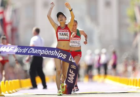 Athletics - World Athletics Championships – women's 20 km walk – London Stadium, London, Britain – August 13, 2017 – Jiayu Yang of China crosses the finish line to win a gold medal. REUTERS/Matthew Childs