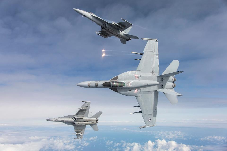 Three F/A-18E aircraft assigned to the Knighthawks of Strike Fighter Squadron (VFA) 136 from Naval Air Station (NAS) Lemoore flown by Lt. Phil