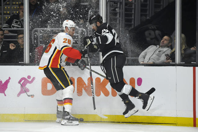 Calgary Flames defenseman Michael Stone, left, and Los Angeles Kings right wing Marin Frk collide during the second period of an NHL hockey game Wednesday, Feb. 12, 2020, in Los Angeles. (AP Photo/Mark J. Terrill)