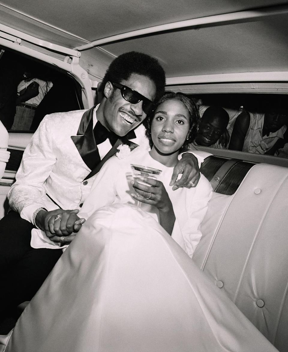 <p>Stevie Wonder and his bride, Motown singer Syreeta Wright, toast to their nuptials with champagne as they leave the Bernette Baptist Church in Detroit, Michigan where they made it official.</p>