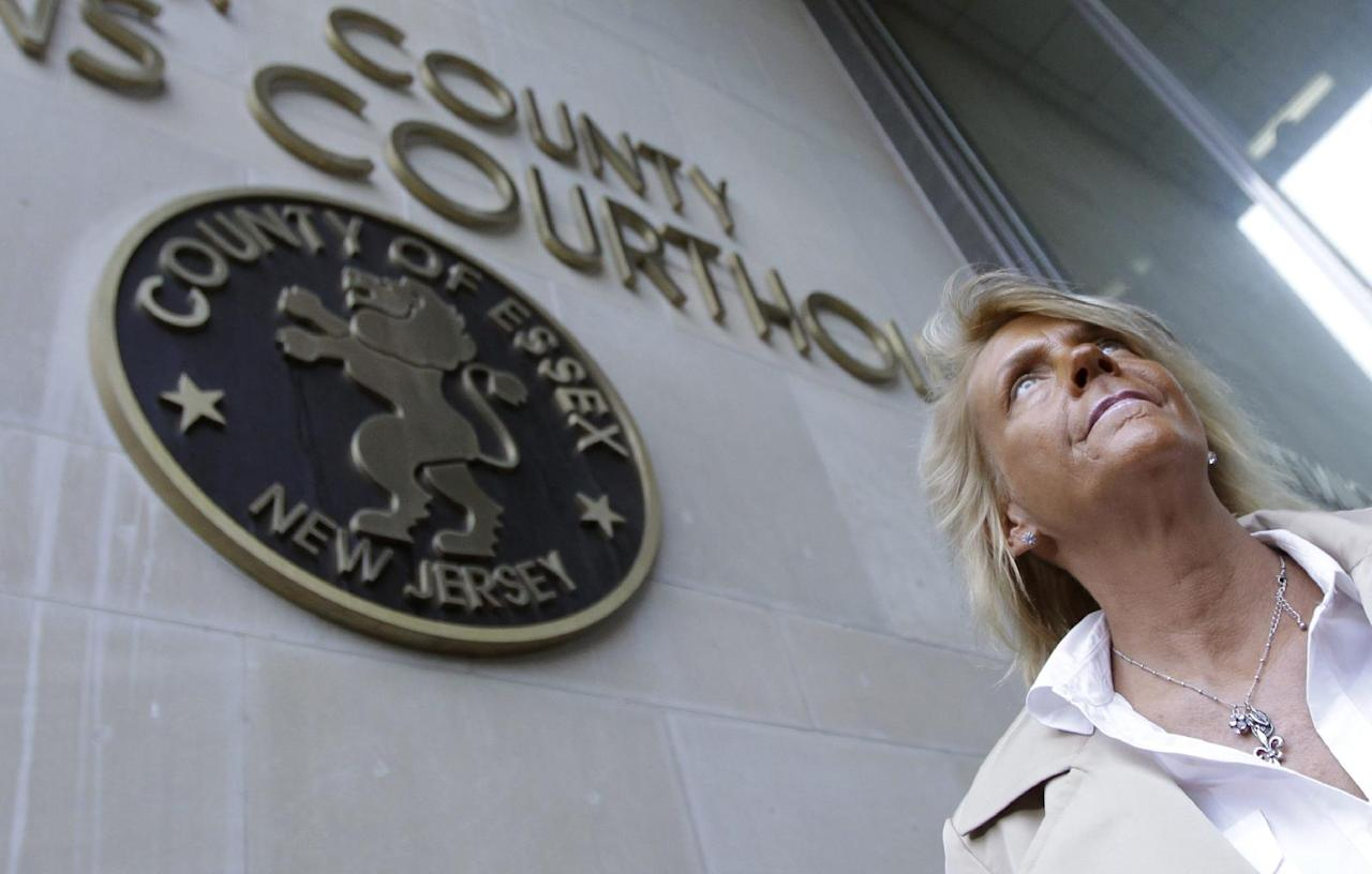 Patricia Krentcil, 44, walks out of Essex County Superior Court after court appearance on charges of child endangerment, Wednesday, May 2, 2012 in Newark, N.J. Krentcil is accused of taking her 5-year-old child into a tanning booth. Krentcil tells The Associated Press her daughter got her sunburn from being outside on a recent warm day. New Jersey state law prohibits anyone under 14 from using tanning salons.(AP Photo/Julio Cortez)