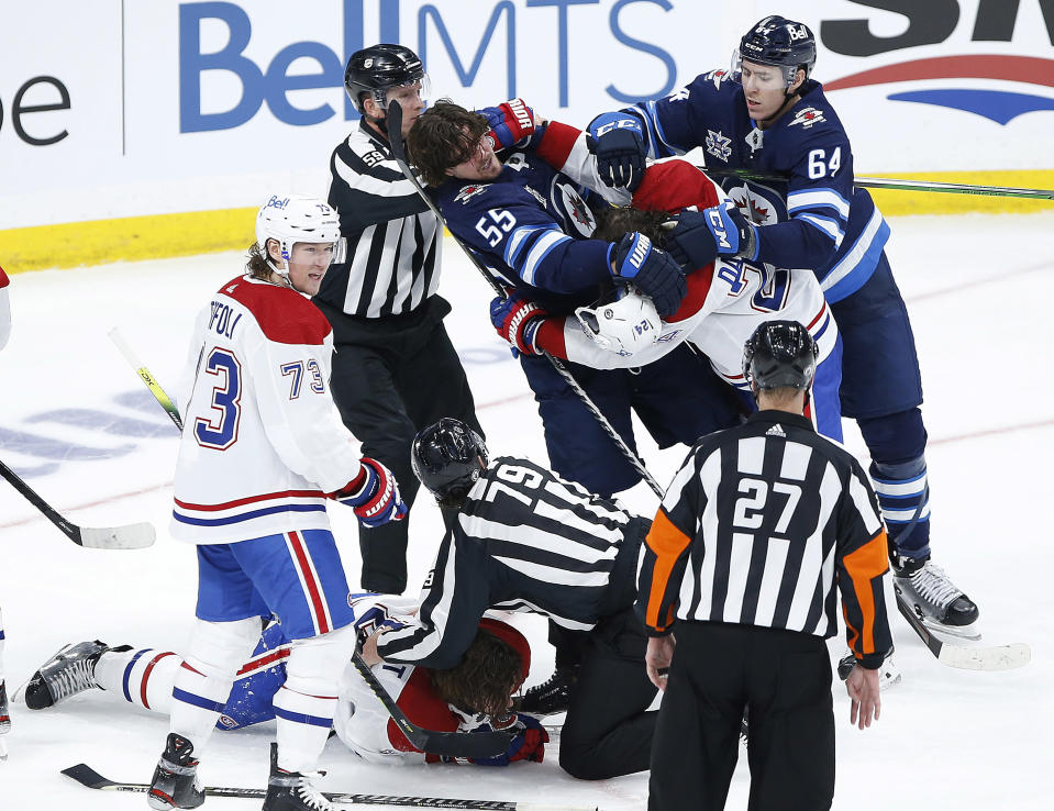 Winnipeg Jets' Mark Scheifele (55) fights with Montreal Canadiens' Phillip Danault (24) during the third period of Game 1 of an NHL hockey Stanley Cup second-round playoff series Wednesday, June 2, 2021, in Winnipeg, Manitoba. (John Woods/The Canadian Press via AP)