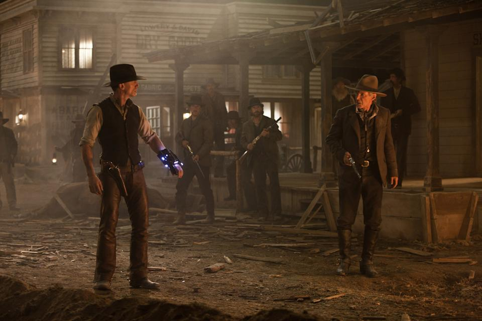 Craig and Ford survey the damage after an alien attack in a scene from Cowboys & Aliens (Photo: Universal Pictures/Courtesy Everett Collection)
