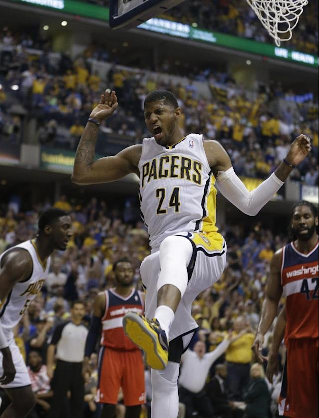 Indiana Pacers' Paul George (24) dunks during the second half of game 2 of the Eastern Conference semifinal NBA basketball playoff series against the Washington Wizards Wednesday, May 7, 2014, in Indianapolis. Indiana defeated Washington 86-82. (AP Photo/Darron Cummings)