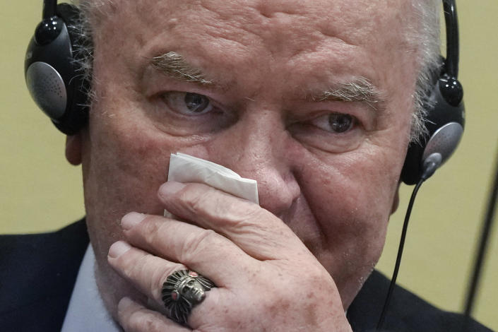 Former Bosnian Serb military chief Ratko Mladic sits in the court room in The Hague, Netherlands, Tuesday, June 8, 2021, where the United Nations court delivers its verdict in the appeal of Mladic against his convictions for genocide and other crimes and his life sentence for masterminding atrocities throughout the Bosnian war. (AP Photo/Peter Dejong, Pool)