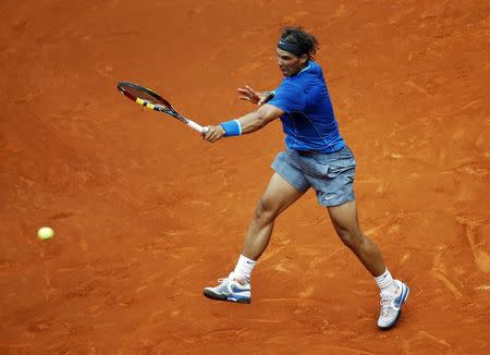 Nadal of Spain returns the ball to Monaco of Argentina during their match at the Madrid Open tennis tournament