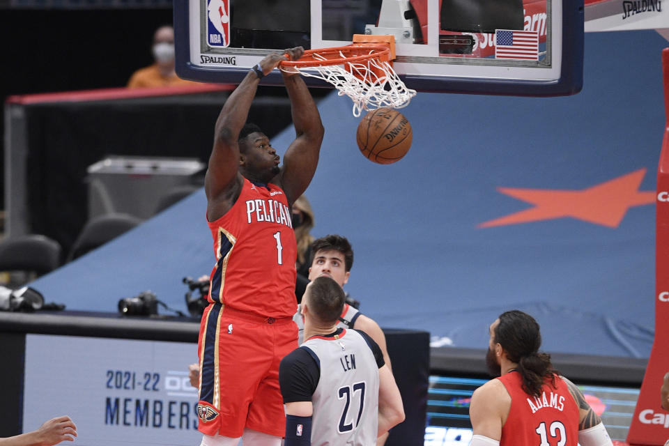 New Orleans Pelicans forward Zion Williamson (1) dunks over Washington Wizards center Alex Len (27) during the first half of an NBA basketball game Friday, April 16, 2021, in Washington. (AP Photo/Nick Wass)