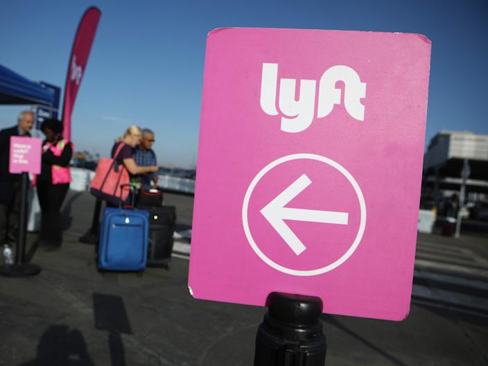 """Lyft and Uber were dealt a major legal defeat this week in their battle over drivers' employment status in California. <p class=""""copyright"""">Mario Tama/Getty Images</p>"""