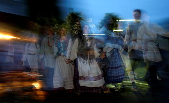 People in national Belarussian clothes dance as they take part in the Ivan Kupala festival, which celebrates the summer solstice, near the town of Oktyabrski, Belarus, June 23, 2018. REUTERS/Vasily Fedosenko TPX IMAGES OF THE DAY