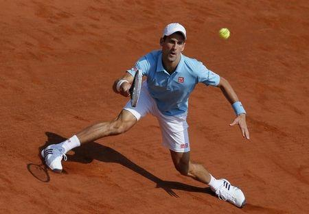 Novak Djokovic of Serbia returns the ball to Rafael Nadal of Spain during their men's singles final match at the French Open Tennis tournament at the Roland Garros stadium in Paris June 8, 2014. REUTERS/Gonzalo Fuentes