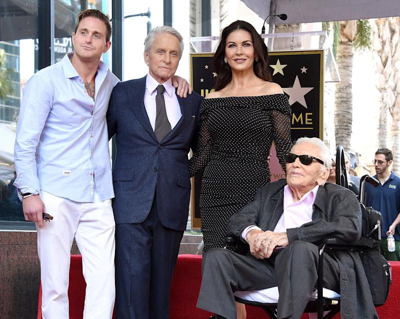 HOLLYWOOD, CA - NOVEMBER 06: Cameron Douglas, Michael Douglas, Catherine Zeta-Jones, and Kirk Douglas pose at the Michael Douglas Star On The Hollywood Walk Of Fame ceremony on November 6, 2018 in Hollywood, California. (Photo by Gregg DeGuire/Getty Images)