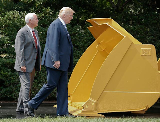 "<p>President Trump and Vice President Mike Pence walk past a Caterpillar truck manufactured in Illinois on the South Lawn of the White House in Washington during a ""Made in America"" product showcase featuring items created in each of the 50 U.S. states on July 17, 2017. (AP Photo/Pablo Martinez Monsivais) </p>"