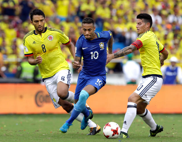 FILE - In this Tuesday, Sept. 5, 2017 filer, Brazil's Neymar, center, fights for the ball with Colombia's Abel Aguilar, left, and James Rodriguez, during a 2018 Russia World Cup qualifying soccer match at the Roberto Melendez stadium in Barranquilla, Colombia. (AP Photo/Fernando Vergara, File)