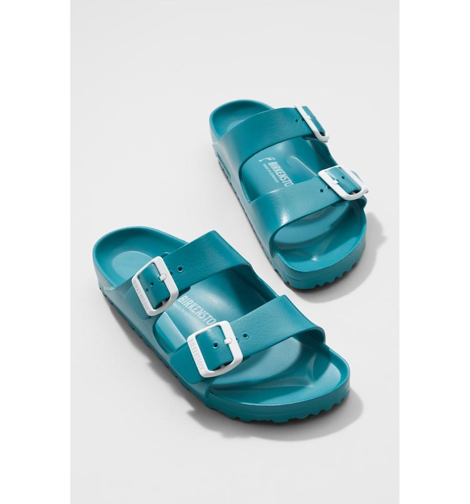 """<h2>EVA Waterproof Sandals</h2> <br>Birkenstocks made their comeback a while back — but, <a href=""""https://www.refinery29.com/en-us/pool-slides"""" rel=""""nofollow noopener"""" target=""""_blank"""" data-ylk=""""slk:waterproof slide sandals"""" class=""""link rapid-noclick-resp"""">waterproof slide sandals</a> earned their trending spot on this summer's shopping radar. This exemplary cool-blue style picked up major cart steam after receiving <a href=""""https://www.refinery29.com/en-us/best-selling-products-online-now"""" rel=""""nofollow noopener"""" target=""""_blank"""" data-ylk=""""slk:a fleeting spot featured in our weekly coverage of bestselling items"""" class=""""link rapid-noclick-resp"""">a fleeting spot featured in our weekly coverage of bestselling items</a>.<br><br>With nearly 2,000 reviews on Nordstrom and a 4.6 out of 5-star rating, plus another 73 reviews and a nearly 5-star rating on <a href=""""https://www.zappos.com/p/birkenstock-arizona-essentials-white-eva/product/9457537/color/142471"""" rel=""""nofollow noopener"""" target=""""_blank"""" data-ylk=""""slk:Zappos"""" class=""""link rapid-noclick-resp"""">Zappos</a>, the cushioned rubber-like twist on the iconic strapped sandal comes customer-vetted and approved: from """"Sent to my mother for an early Mother's Day gift. She loves them! She reports she has worn them every day since they arrived,"""" to, """"These are perfect for poolside or beach slip-on. Sand washes right off. Very comfortable.""""<br><br><em>For more color options shop</em> <strong><a href=""""https://www.nordstrom.com/brands/birkenstock--86"""" rel=""""nofollow noopener"""" target=""""_blank"""" data-ylk=""""slk:Nordstrom"""" class=""""link rapid-noclick-resp"""">Nordstrom</a></strong>, <em><strong><a href=""""https://www.urbanoutfitters.com/shop/birkenstock-arizona-eva-sandal"""" rel=""""nofollow noopener"""" target=""""_blank"""" data-ylk=""""slk:Urban Outfitters"""" class=""""link rapid-noclick-resp"""">Urban Outfitters</a></strong>, <strong><a href=""""https://www.freepeople.com/shop/eva-arizona-birkenstock-sandal/"""" rel=""""nofollow noopener"""" target=""""_blank"""" data-ylk=""""slk:Free People"""""""