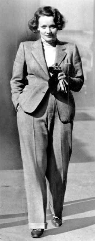 Actress Marlene Dietrich wears a trendsetting masculine style pant suit created by French couturiere Coco Chanel in 1933 at an unknown location. (AP Photo)