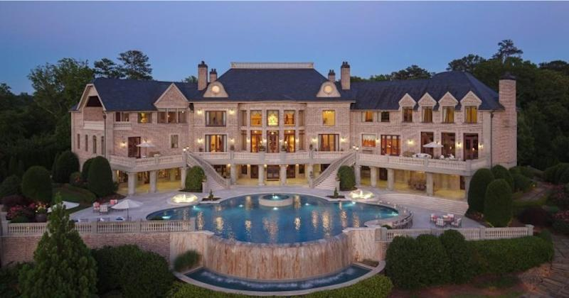 Spanning 17 acres, the estate includes a French Proverbial-style mansion, 70,000-gallon pool and tennis court set among rolling lawns and gardens.