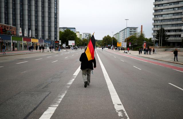 """<p>A supporter of the far-right """"Pro Chemnitz"""" holds a flag during a demonstration in Chemnitz, Germany, Sept. 1, 2018. (Photo: Hannibal Hanschke/Reuters) </p>"""