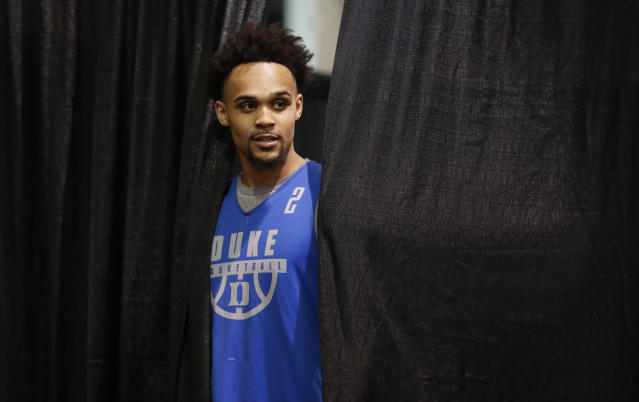 Duke guard Gary Trent Jr. enters a news conference at the NCAA men's college basketball tournament, Saturday, March 24, 2018, in Omaha, Neb. Duke faces Kansas in a regional final on Sunday. (AP Photo/Charlie Neibergall)