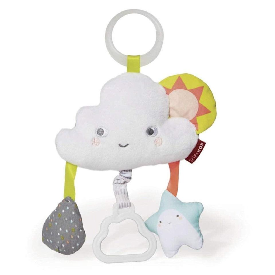 <p>This <span>Skip Hop Silver Lining Cloud Jitter Stroller Toy</span> ($10) has the most appealing color scheme and so many elements.</p>
